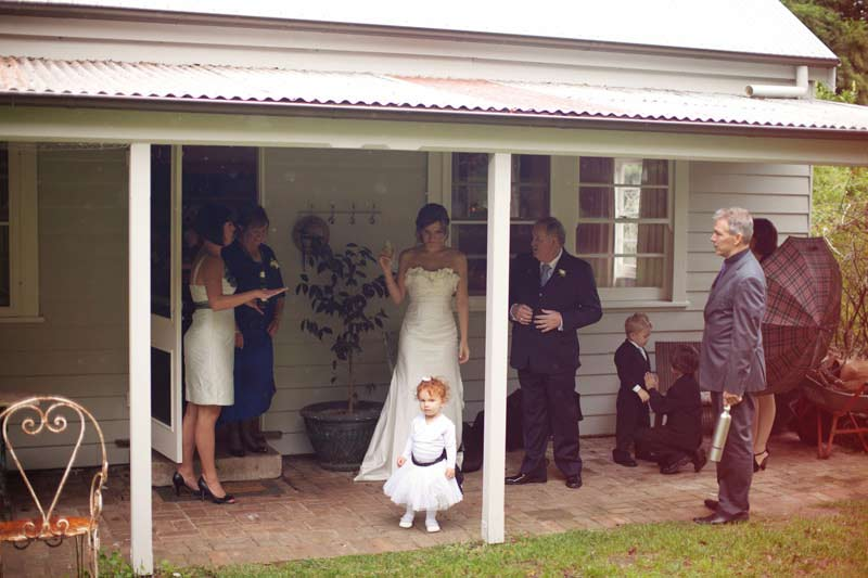 Bridal party outside house