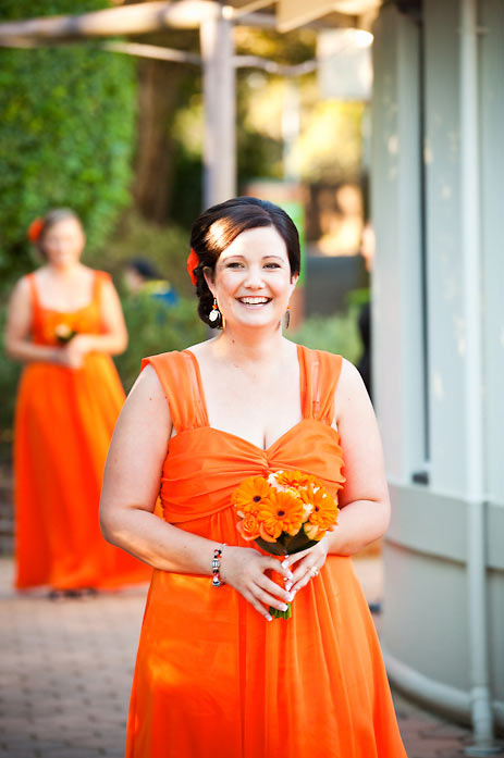 Walking down the aisle-orange bridesmaids