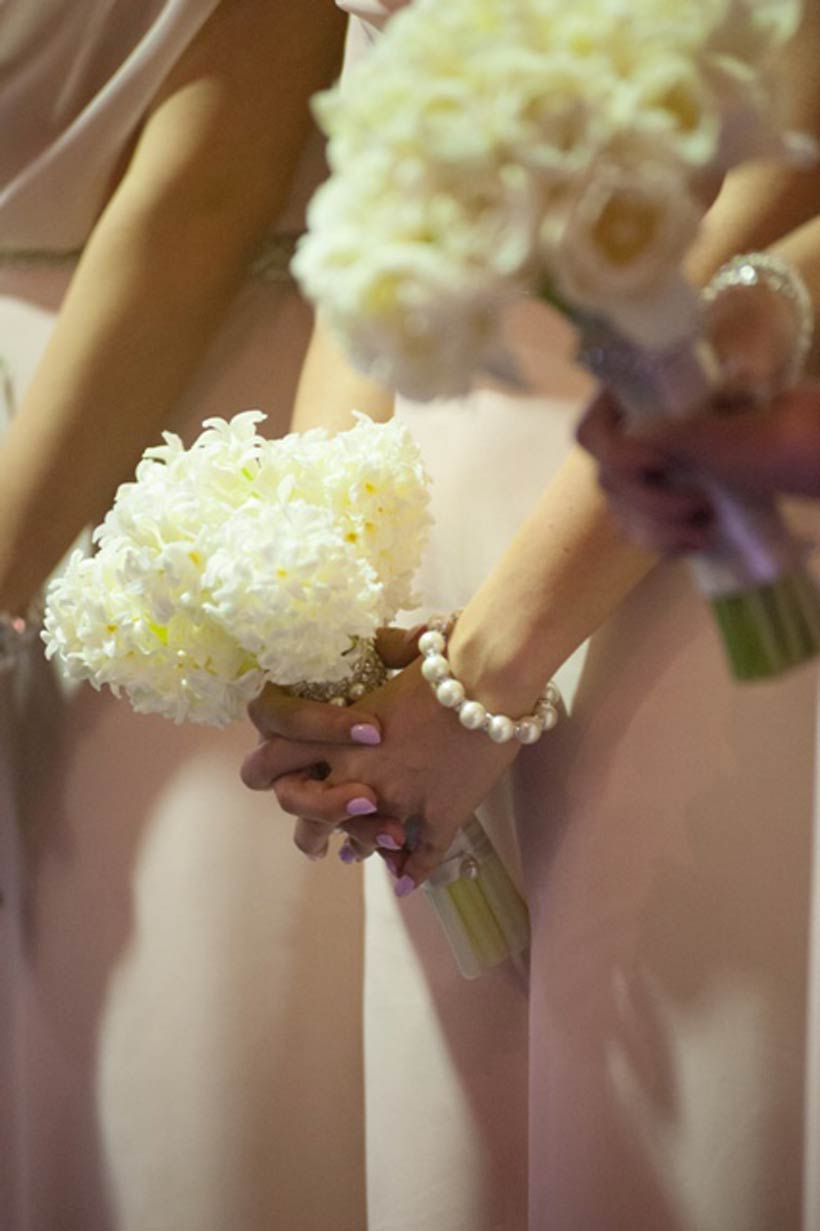 The beautiful interplay of the pink bridesmaid dresses and white bouquets