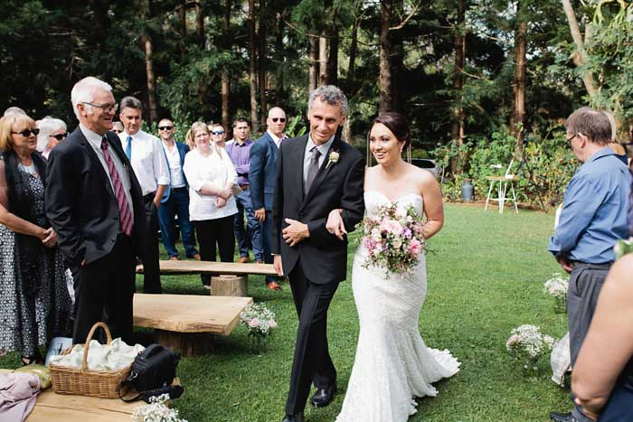 fater of the bride walks down aisle