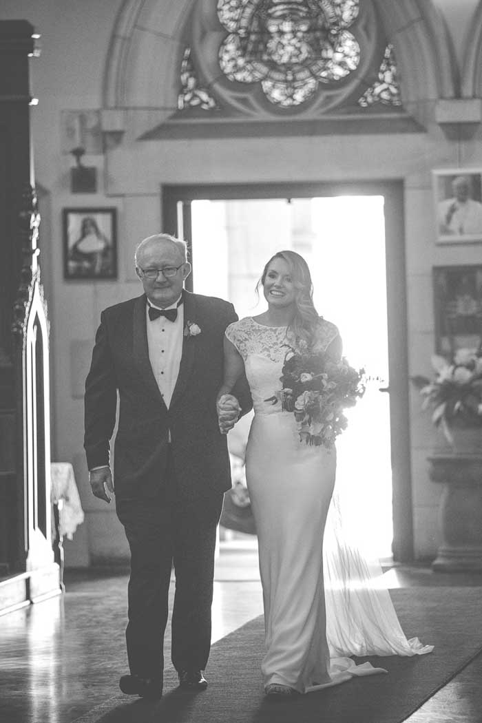 father of the bride and bride walking down the aisle