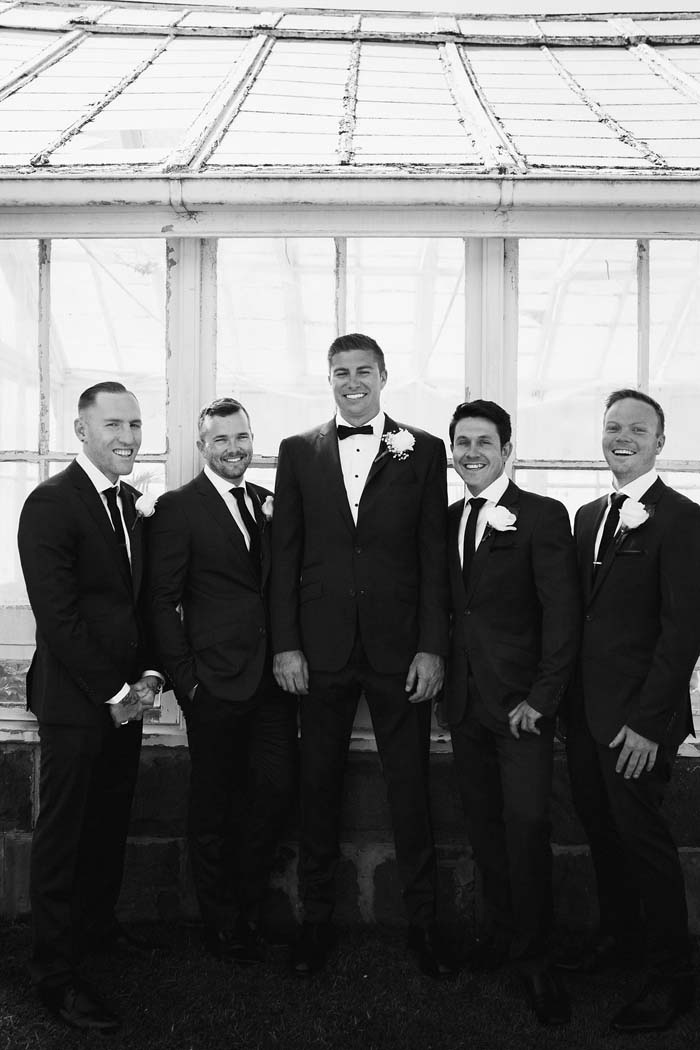 elegant real wedding groomsmen
